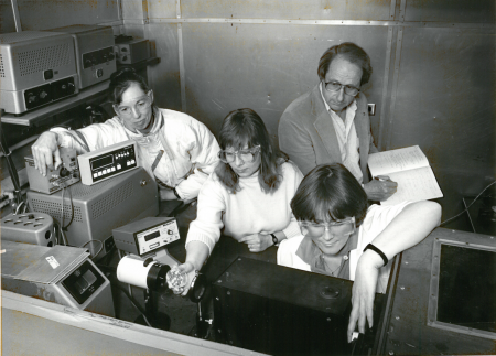 From left: Betsy, Judi Romeo, John, and Elsie Quiate (now Quiate-Randall) prepare to irradiate alfalfa seeds