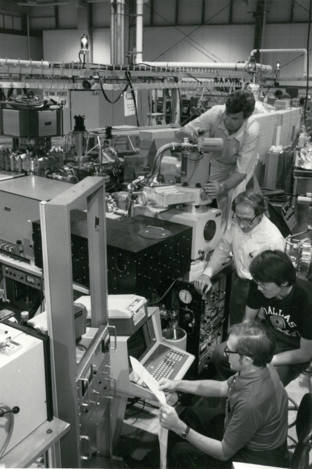 First extramural users of John's U9B beamline. From front: Donald M. Gray, at the University of Texas, Dallas (UTD); Young Yang, then a graduate student at UTD; John; and Dimitrij Lang, also at UTD